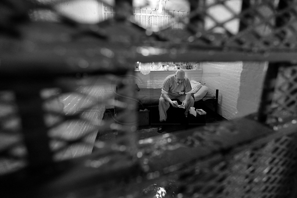 Robert Potvin reads a book after lockdown in his cell.  Mr Potvin will be in the jail for a totalof 15 months after being sentenced.  The Bristol County Jail & House of Correction located on Ash Street in New Bedford, Massachusetts was started in 1829, and is the oldest running jail in the United States.   The Ash street jail, as it is known, has been a controversial facility since it opened.  It is believed to be the site of the last pubic hanging in Massachusetts sometime in the 1890's.  Two big riots broke out in the 90's (1993, 1998) and since then the facility has been modified to alleviate some of the crowded conditions that resulted in the riots.