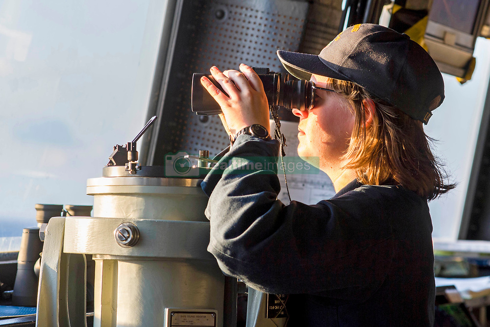 180930-N-PH222-1139 MEDITERRANEAN SEA (Sept. 30, 2018) Ensign Taylor Poynter stands watch as conning officer in the pilothouse of San Antonio-class amphibious transport dock ship USS Anchorage (LPD 23) Sept. 30, 2018. Anchorage and embarked 13th Marine Expeditionary Unit are deployed to the U.S. 6th Fleet area of operations as a crisis response force in support of regional partners as well as to promote U.S. national security interests in Europe and Africa. (U.S. Navy photo by Mass Communication Specialist 3rd Class Ryan M. Breeden/Released)