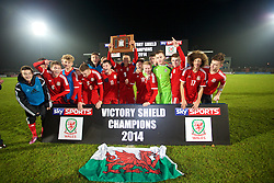 BALLYMENA, NORTHERN IRELAND - Thursday, November 20, 2014: Wales' captain Tyler Roberts lifts the Victory Shield trophy as the players celebrate after beating Northern Ireland 2-0 during the Under-16's Victory Shield International match at the Ballymena Showgrounds. Max Smallcombe, Keiron Proctor, Daniel Jefferies, Liam Cullen, captain Tyler Roberts, Keiran Evans, Ben Williams, goalkeeper Scott Coughlan, Ben Woodburn, Ethan Ampadu, Liam Angel. (Pic by David Rawcliffe/Propaganda)