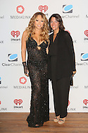 CAP D'ANTIBES, FRANCE - JUNE 17:  Mariah Carey and Amy Newman, SVP of Marketing Solutions, Clear Channel attend Clear Channel Media And Entertainment And MediaLink Dinner at Hotel du Cap-Eden-Roc on June 17, 2014 in Cap d'Antibes, France.  (Photo by Tony Barson/Getty Images for Clear Channel)