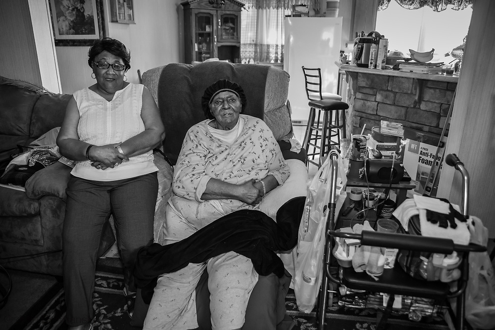 Brenda Bryant with her mother Genevia Shepard at home in St. James. Brenda has trouble walking, and her mother cannot move around on her own.