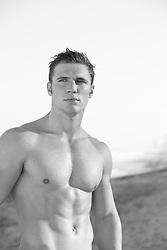 shirtless muscular man outdoors