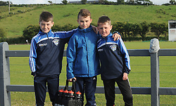Filling the water bottles Sean Walsh, James McLoughlin and Gavin Walsh from Killala at the junior championship match on saturday evening last.<br /> Pic Conor McKeown