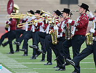 """Sean Herrmann kicks his foot up as he plays the saxophone during the Mount Vernon High School Marching Band performance at the State Marching Band Festival at Kingston Stadium in Cedar Rapids on Saturday October 6, 2012. Their program included """"You Can Call Me Al"""", """"Smells Like Teen Spirit"""", """"Clocks"""", and """"The Edge of Glory""""."""