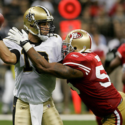 August 12, 2011; New Orleans, LA, USA; New Orleans Saints quarterback Chase Daniel (10) is pressured by San Francisco 49ers linebacker Ahmad Brooks (55) during the first half of a preseason game at the Louisiana Superdome. Mandatory Credit: Derick E. Hingle