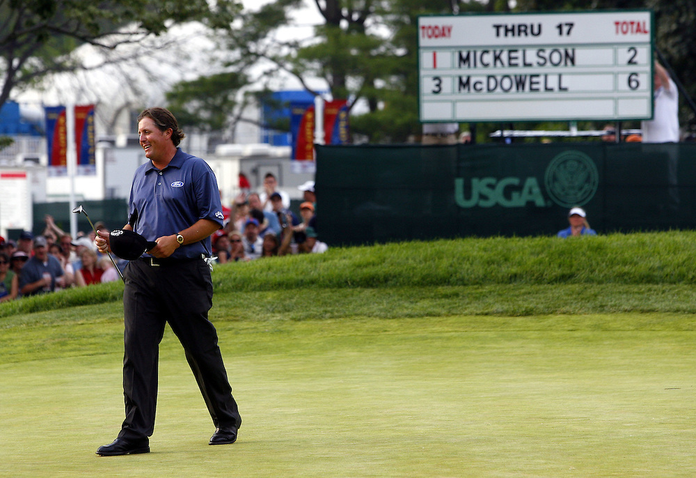 Phil Mickelson of the US smiles as he walks off the eighteenth green after finishing his round during the third day of the US Open Golf Championship at Winged Foot Golf Club in Mamaroneck, New York Saturday, 17 June 2006. .