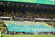 Norwich fans unfurl a huge flag before the EFL Sky Bet Championship match between Norwich City and Sheffield Wednesday at Carrow Road, Norwich, England on 19 April 2019.