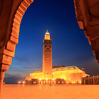 Hassan II Mosque illuminated at dusk, Casablanca, Morocco.