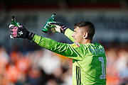 Dimitar Evtimov of Accrington showing the referee beer bottles thrown onto the pitch by Blackpool fans  during the EFL Sky Bet League 1 match between Accrington Stanley and Blackpool at the Fraser Eagle Stadium, Accrington, England on 21 September 2019.