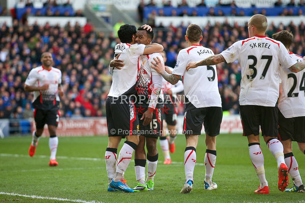 CARDIFF, WALES - Saturday, March 22, 2014: Liverpool's Luis Suarez celebrates scoring the fourth goal against Cardiff City with team-mate Daniel Sturridge during the Premiership match at the Cardiff City Stadium. (Pic by David Rawcliffe/Propaganda)