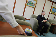 Female employee places a cup of green tea for a guest of Fujio Mitarai, President and CEO of Canon Inc., (one of the leading Japanese electronics and camera manufacturing companies), during an interview, in Tokyo, Japan on Tuesday, Sept. 11th 2004. During interviews it is common for female assistants to enter the rooms silently , bringing refreshment drinks of green tea, coffee, or orange juice, to the company head and his guests.