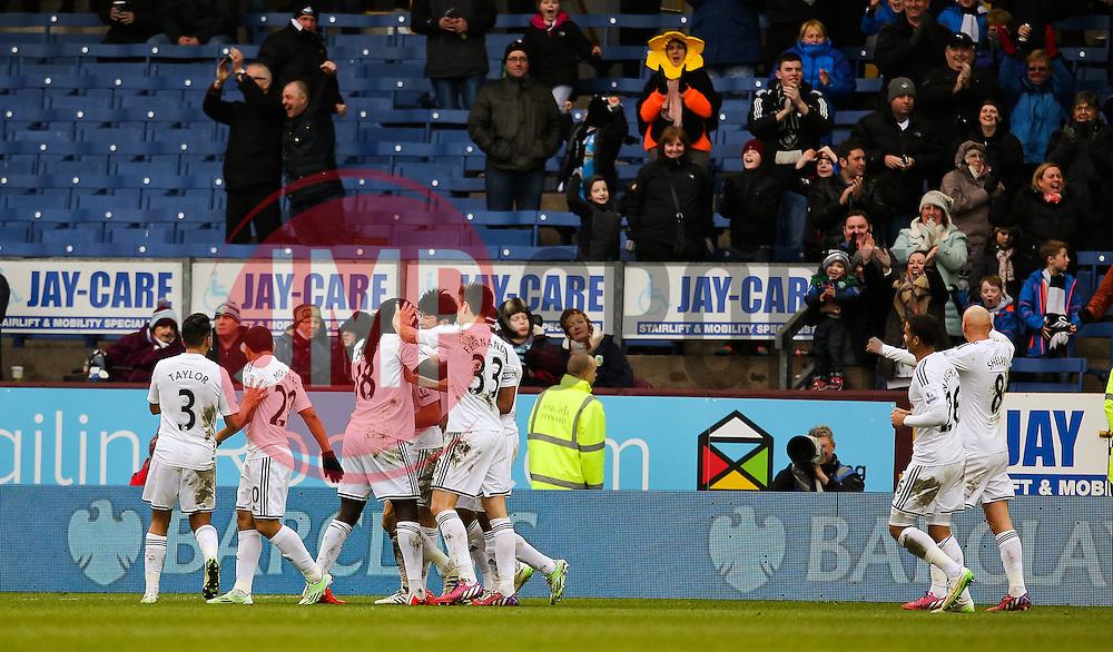 Swansea players celebrate after Burnley's Kieran Tripper scores an own goal  - Photo mandatory by-line: Matt McNulty/JMP - Mobile: 07966 386802 - 28/02/2015 - SPORT - Football - Burnley - Turf Moor - Burnley v Swansea City - Barclays Premier League
