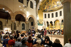 "Dr. Kim Phúc attends the Philadelphia Orchestra performance of Children of the Fire, by composer-in-residence Hannibal Lokumbe at the Philadelphia Episcopal Cathedral in West Philadelphia, on Saturday. Dr. Phúc is the subject of the iconic 1972 ""Napalm Girl"" Pulitzer Prize-wining photograph by now-retired Associated Press photographer Nick Ut. (Bastiaan Slabbers for WHYY)"