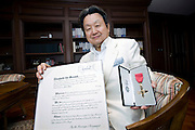 Yuzo Yagi, president and CEO of Yagi Tsusho Ltd., displays his medal and certificate signed by HM Queen Elizabeth II after an interview at his company's offices in Tokyo, Japan on 28 July, 2011. In June, Yagi received an honorary OBE in recognition of his contribution to business relations between Japan and the UK..Photographer: Robert Gilhooly