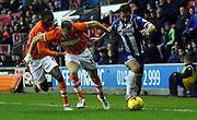 Blackpool Defender Tom Aldred battles with Wigan Defender Reece James during the Sky Bet League 1 match between Wigan Athletic and Blackpool at the DW Stadium, Wigan, England on 12 December 2015. Photo by Pete Burns.