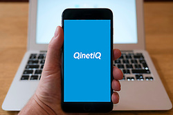 Logo of Qinetiq defence industry group  on smart phone screen.