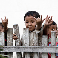 Children in Luwuk, Central Sulawesi gesture