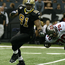 2007 December, 2: New Orleans Saints defensive end Will Smith (91) rushes past Buccaneers tackle Donald Penn (70) during a 27-23 win by the Tampa Bay Buccaneers over the New Orleans Saints at the Louisiana Superdome in New Orleans, LA.