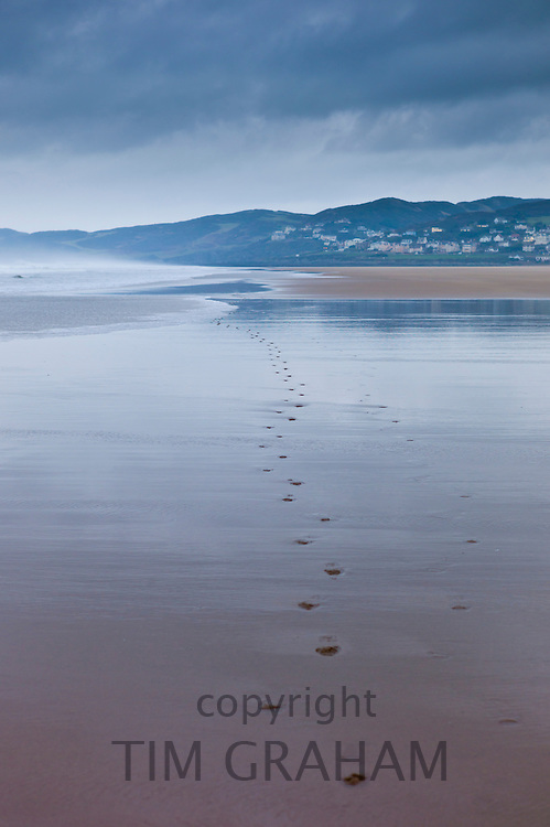 Footprints in the sand at Woolacombe, North Devon, UK