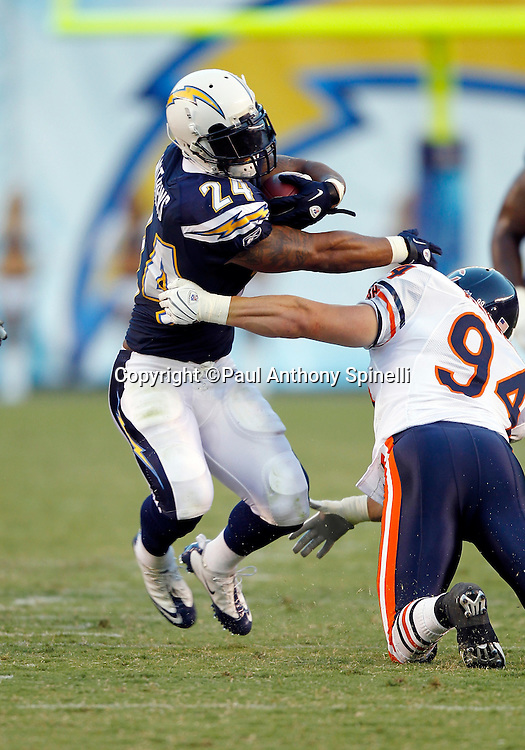 San Diego Chargers rookie running back Ryan Matthews (24) dodges a tackle attempt by Chicago Bears rookie linebacker Matt Mayberry (94) as he runs the ball after catching a pass during a NFL week 1 preseason football game against the Chicago Bears, Saturday, August 14, 2010 in San Diego, California. The Chargers won the game 25-10. (©Paul Anthony Spinelli)