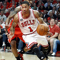 10 May 2011: Chicago Bulls point guard Derrick Rose (1) drives past Atlanta Hawks guard Jeff Teague (0) during the Chicago Bulls 95-83 victory over the Atlanta Hawks, during game 5 of the Eastern Conference semi finals at the United Center, Chicago, Illinois, USA.