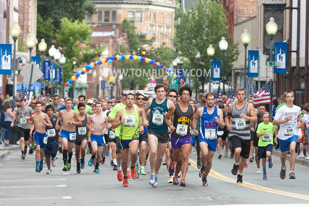 Middletown, New York - Male runners take off at the start of  the Orange Regional Medical Center's Run 4 Downtown road race on Aug. 16, 2014. All the proceeds from the Run 4 Downtown go to revitalizing Middletown's Historic district.