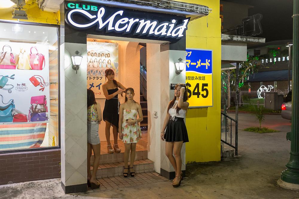 Girls waiting for customers at the massage parlor (legit, it's said) in Saipan's downtown.