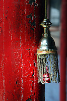 China, Wutai Shan, 2008. A tiny decorative bell graces this peeling column along a walkway of Xiantong Temple, a vast Wutai monastery with over four hundred rooms.