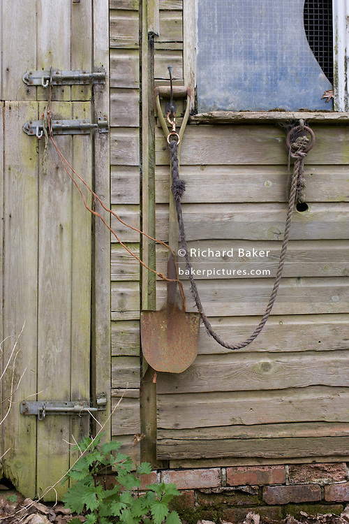 Detail of ramshackle stable outbuilding in Kent countryside.