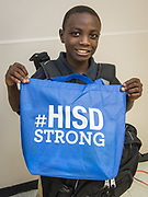 Students at the Academic and Behavioral School West receive backpacks and supplies from the Houston ISD Special Education Department, September 27, 2017.