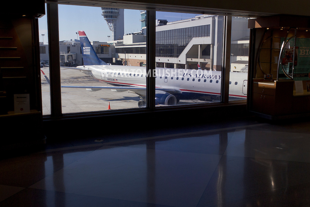 Philadelphia, Pennsylvania - A US Airways Embraer 190 jet airplane is visible through a window at Philadelphia at Philadelphia International Airport on Jan. 26, 2013.