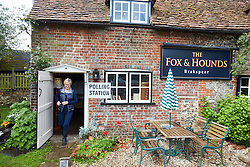 © Licensed to London News Pictures.  07/05/2015. OXFORD, UK. General view (GV) of a polling station inside The Fox and Hounds pub in Christmas Common, in south Oxfordshire. *** Taken with permission of officials, pub and voters ***.  Photo credit: Cliff Hide/LNP