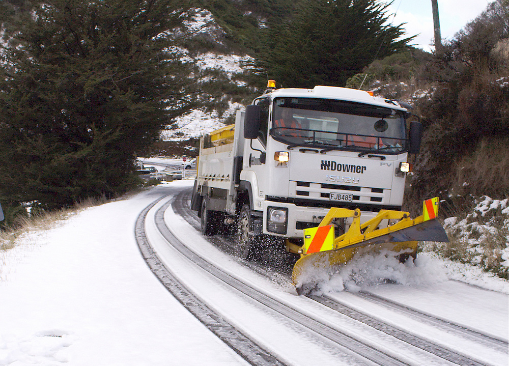 A snow plough clears the road after the first season's snowfall on the Port Hills, Christchurch, New Zealand, Tuesday, April 14, 2015. Credit:SNPA / Sam Hoeflich