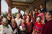 Ruth and Rosa Hollows with patients, monks and international doctors after patches have been taken off at Pullarhari Monestry for the outreach micro surgical eye camp held on the outsirks of the Kathmandu Valley 2014.
