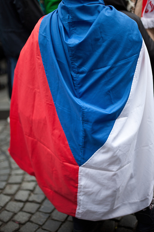 Woman wrapped into a Czech National flag during a rally against the Czech government's social reforms and budget cuts at Wenceslas Square during the 17th of November 2011 -  the national holiday (Day of Struggle for Freedom and Democracy) in Prague.
