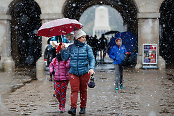 © Licensed to London News Pictures. 10/12/2017. London, UK. People walk in snow at Horse Guards Parade during a heavy snowfall in London on Sunday, 10 December 2017. Photo credit: Tolga Akmen/LNP