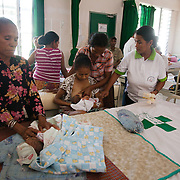 An Alola health worker help a woman breast feed her new born baby in the maternity ward. Infant mortality rates are very high in Timor-Leste and one of the reasons for that is poor nutrition. Alola advocate breast feeding till at least two years old and teach women about nutritious supplements such as boiled and mashed rice w vegetables and eggs.  Fundasaun Alola is a not for profit non government organization operating in Timor Leste to improve the lives of women and children. Founded in 2001 by the then First Lady, Ms Kirsty Sword Gusmao, the organization seeks to nurture women leaders and advocate for the rights of women.