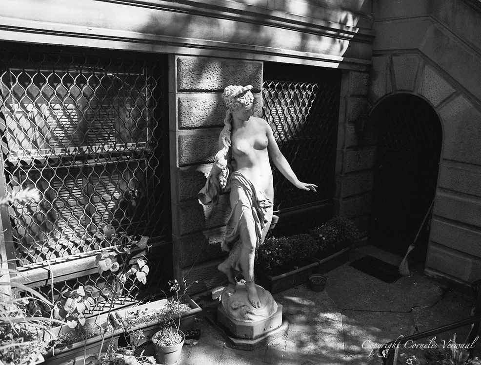 Sculpture of a nude in front of a townhouse on 80th street between Madison and Park on the north side.