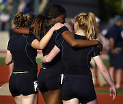 05/23/2009 - Lincoln teammates walk arm-in-arm after finishing the 6A Girl's 4x400 Meter Relay. The 2009 OSAA/U.S. Bank/Les Schwab Tires 6A-5A-4A Track and Field State Championships were run at Hayward Field in Eugene, Oregon.....KEYWORDS:  City, Portland, sports, Oregon, high school, OSAA, boys, girls, PIL, run, University, team