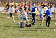 Warwick, N.Y. - Runners sprint past the starters at the beginning of a boys' race at the New York State Public High School Athletic Association cross country championships at Sanfordville Elementary School on Nov. 11, 2006. The runners are blurred because of slow shutter speed.<br />