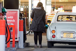© London News Pictures. 06/01/2011. FILE PICTURE. A  Motorist filling her car with petrol in London. Workers should expect another year of pain, with pay freezes or pay rises well below inflation, researchers have claimed. People are already struggling to make ends meet on their current salary, particularly following the recent rises in VAT and petrol prices. Photo credit should be read: London News Pictures....Motorists were queueing for petrol at a Hertford petrol station on the A414 on Christmas Eve before travelling on Christmas Day.