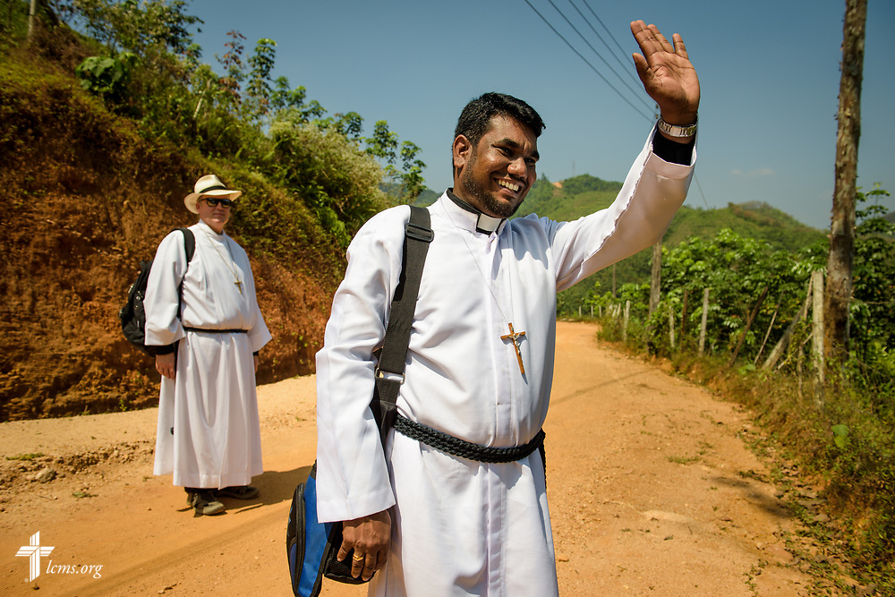 The Rev. P. Gnanakumar waves goodbye to church members on the Eila rubber plantation in the Sabaragamuwa Province of Sri Lanka following worship on Sunday, Jan. 21, 2018. Behind him is the Rev. Steven Mahlburg, LCMS career missionary to Sri Lanka. LCMS Communications/Erik M. Lunsford