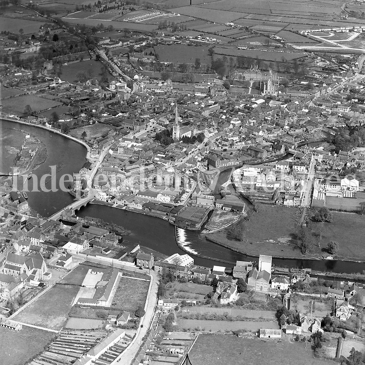 A85 Carlow.   18/01/52. (Part of the Independent Newspapers Ireland/NLI collection.)<br /> <br /> <br /> These aerial views of Ireland from the Morgan Collection were taken during the mid-1950's, comprising medium and low altitude black-and-white birds-eye views of places and events, many of which were commissioned by clients. From 1951 to 1958 a different aerial picture was published each Friday in the Irish Independent in a series called, 'Views from the Air'.The photographer was Alexander 'Monkey' Campbell Morgan (1919-1958). Born in London and part of the Royal Artillery Air Corps, on leaving the army he started Aerophotos in Ireland. He was killed when, on business, his plane crashed flying from Shannon.