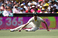 Australian player Pat Cummins fields the ball at the 4th Cricket Test Match between Australia and India at The Sydney Cricket Ground in Sydney, Australia on 03 January 2019.