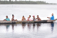 Group of people crossing the water in a dugout canoe, Magical Madagascar, Exotic places photography