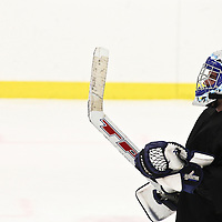 A goalie takes a breather while the puck is on the other side of the ice in Great Barrington, Massachusetts.