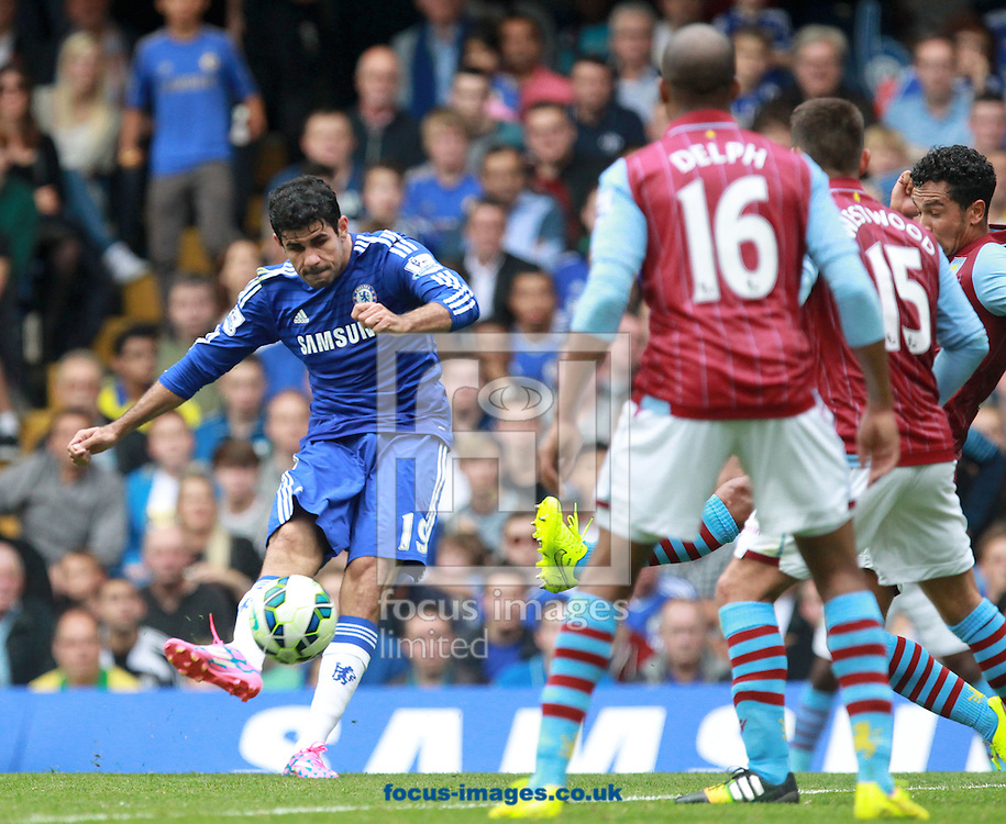 Diego Costa of Chelsea gets in a shot against  Aston Villa during the Barclays Premier League match at Stamford Bridge, London<br /> Picture by John Rainford/Focus Images Ltd +44 7506 538356<br /> 27/09/2014