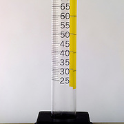 Volumes of liquid being measured in a graduated cylinder.