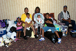 2nd Sept, 2005. New Orleans, Louisiana.<br /> The Allen family awaiting evacuation.  Jamie (4yrs) Ricky Allen (dad), Rick Allen the 3rd (2yrs), Sontrica (wife), Rickelle (baby) and Traon (11yrs). Crammed into the darkened Hyatt hotel with all their belongings.<br /> Photo Credit; Charlie Varley/varleypix.com