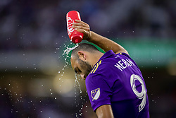 May 13, 2018 - Orlando, FL, U.S. - ORLANDO, FL - MAY 13: Orlando City forward Justin Meram (9) rinses off during the soccer match between the Orlando City Lions and Atlanta United on May 13, 2018 at Orlando City Stadium in Orlando, FL. (Photo by Joe Petro/Icon Sportswire) (Credit Image: © Joe Petro/Icon SMI via ZUMA Press)
